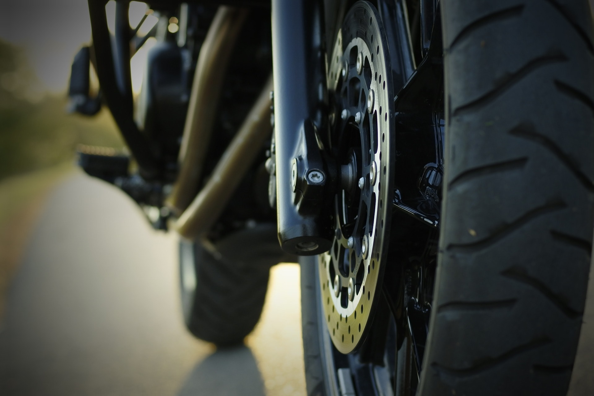 Tire view of a motorcycle. Who takes more braking distance?